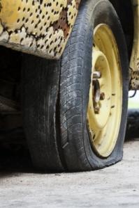 "Flat tire of old car image courtesy of ""Toa 55"" / FreeDigitalPhotos.net"