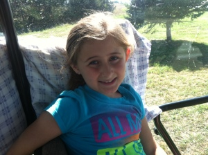 """Here's a """"for no reason"""", random photo of my daughter in the tractor when we were helpin' Grandpa on the farm. See the pillow? She rides in comfort.  Have a great day!"""